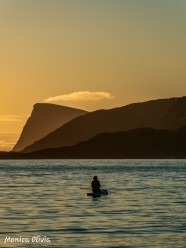 Monica's friend padling in the midnight sun on Sommarøy, Troms